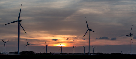 Wind Energy. Wind Turbines or winmills Silhouette during Sunset in Flevoland, The Netherlands.