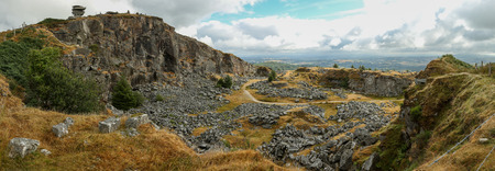 Disused Cheesewring Quarry Pit and  Stowes Hill in Bodmin Moor, Cornwall, England. Panorama.