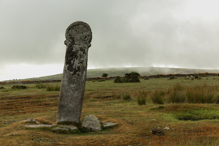 Old Tom or the long Stone on a cloudy and mistic morning in Cornwall near Bodmin in England.
