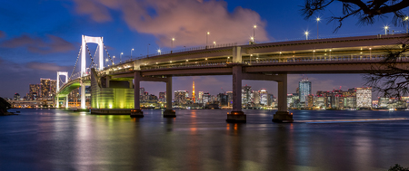 Tokyo Rainbow bridge and Tokyo Tower at sunset with scenic night illumination Sajtókép