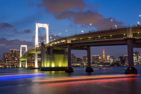 Tokyo Rainbow bridge and Tokyo Tower at sunset with scenic night illumination Редакционное