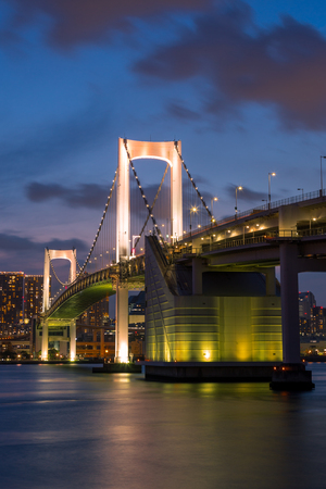 Tokyo Rainbow bridge and Tokyo Tower at sunset with scenic night illumination Editorial