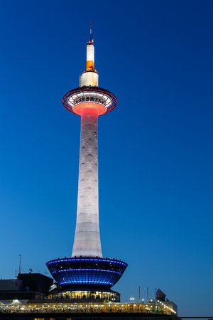 illuminated Kyoto Tower and beautiful dusk blue hour sky at evening time in Kyoto, Japan