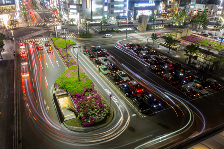 KYOTO, JAPAN - May 04, 2019: Taxi stand at Kyoto main Station, Japan, long exposure image with trails of colorful lights.