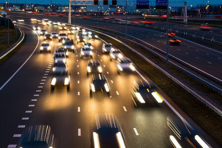 Busy rush hour traffic leaves light trails on the A9 highway near Amsterdam, Schiphol to Haarlem.