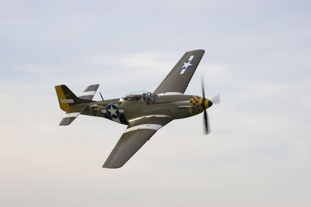 ww2: an old plane at an airshow