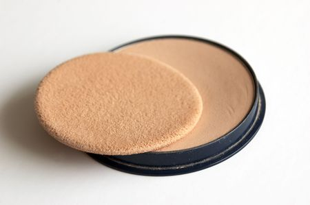 A foundation compact on a white background