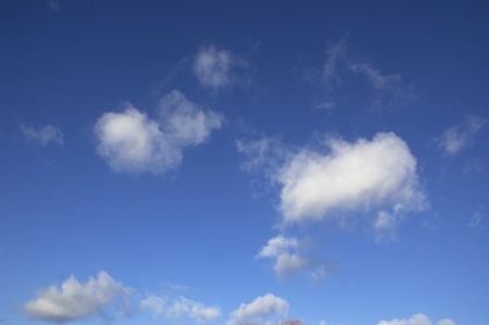 float cotton cloud: A blue sky with some white clouds.  Stock Photo