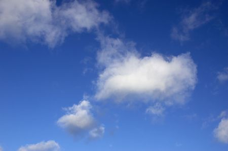 A blue sky with some white clouds.  Stock Photo - 725076