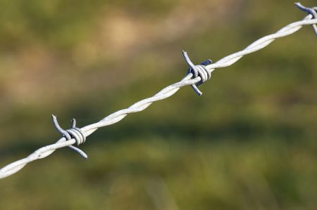 Barbed wire on a fence photo