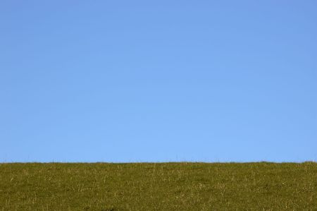 A green field with a blue sky in winter Stock Photo - 767268