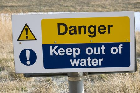 keep out: Danger keep out ,warning sign by deep water Stock Photo