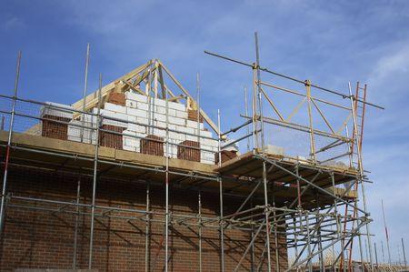 �chafaudages autour d'une nouvelle maison en Angleterre Banque d'images