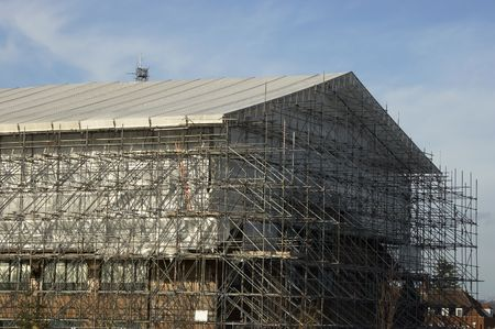 elevated walkway: Scaffolding around a big industrial unit in the UK