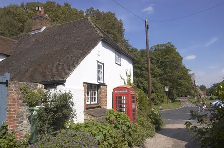 phonebox: A village phonebox by a white cottage