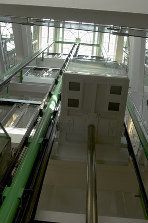A veiw up an elevator shaft with a glass roof