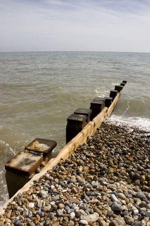 groyne: Groyne leading into the sea on a cold day