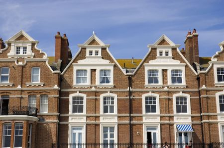 townhouses: A row of victorian townhouses with a blue sky