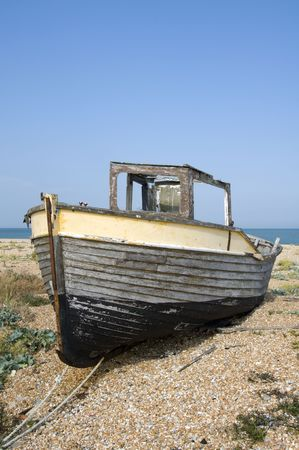 wreckage: An old fishing boat on the beach at Dungeness