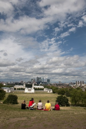 A family looking at a view of the london skyline