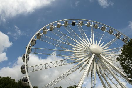 A big ferris wheel with a blue cloudy sky photo