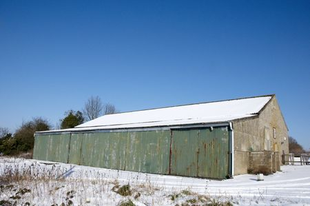 A barn covered in snow with a clear blue sky Stock Photo - 4600958