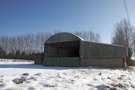 A metal agricultural barn in the snow Stock Photo - 4600951