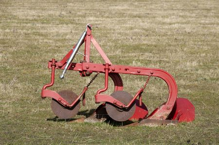 plough: An old plough in a field of grass