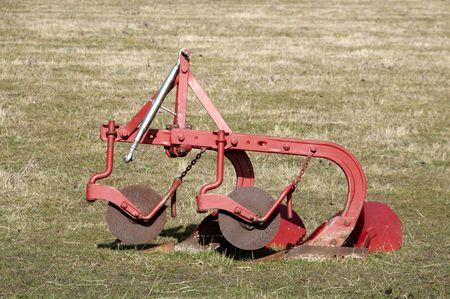 the plough: An old plough in a field of grass