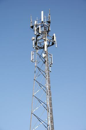 A phone mast against a clear blue sky Stock Photo - 5002832