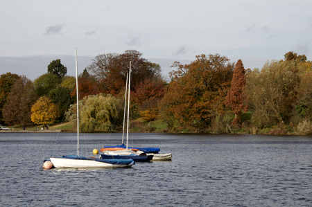 A veiw of Yachts on a lake in autumn Stock Photo