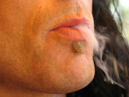 smoke out of man's mouth Stock Photo - 2773824