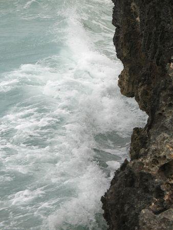 sea crashing on a cliff Stock Photo