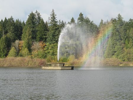 fountain in a lake Stock Photo
