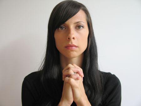 long nose: dark hair girl praying Stock Photo