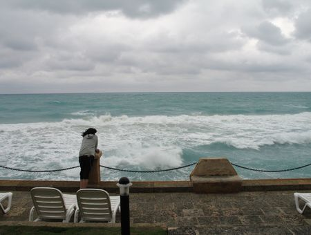man watching the stormy ocean