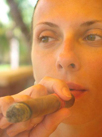 woman smoking a cigar