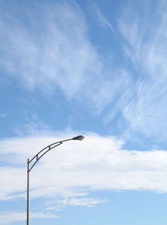 street light against a blue sky