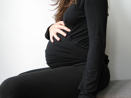belly of a pregnant young woman