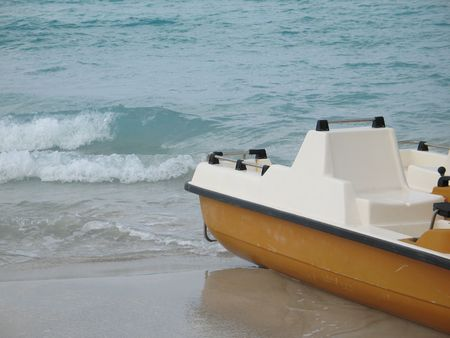yellow paddle boat on the ocean