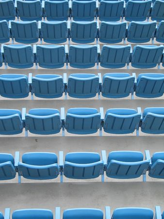 blue aligned plastic chairs Stock fotó