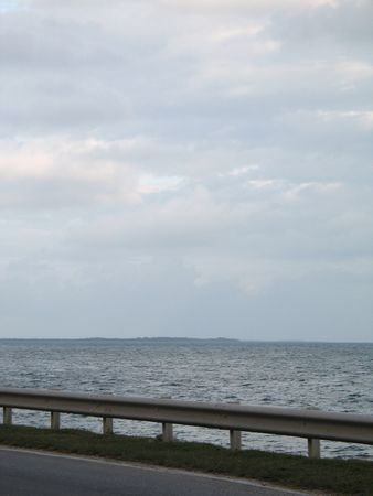 blue tropical ocean view by the road
