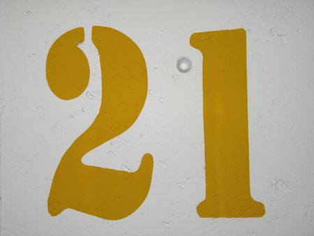 spot: yellow number 21 sign