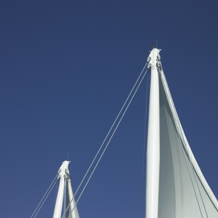 man made structure: White sails and blue sky Stock Photo