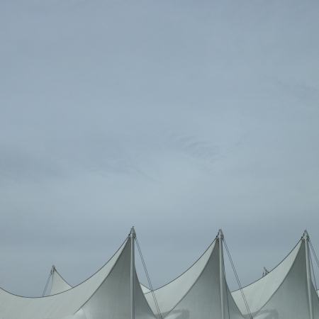 Sails and grey sky photo