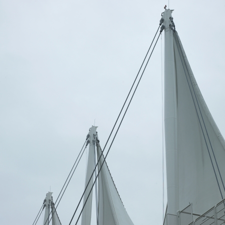 angled view: Sails and grey sky