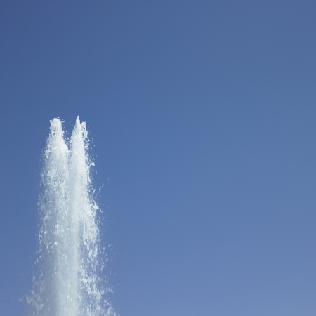 Water fountain and blue sky