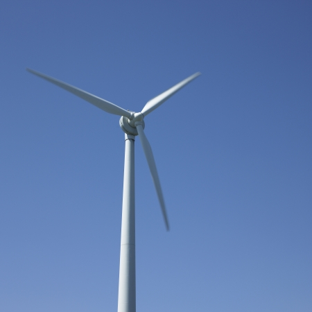 Wind turbine and blue sky photo