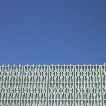 Textured building and blue sky Stock Photo - 18097702