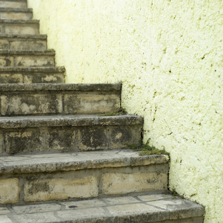 uneven edge: stone steps and yellow wall